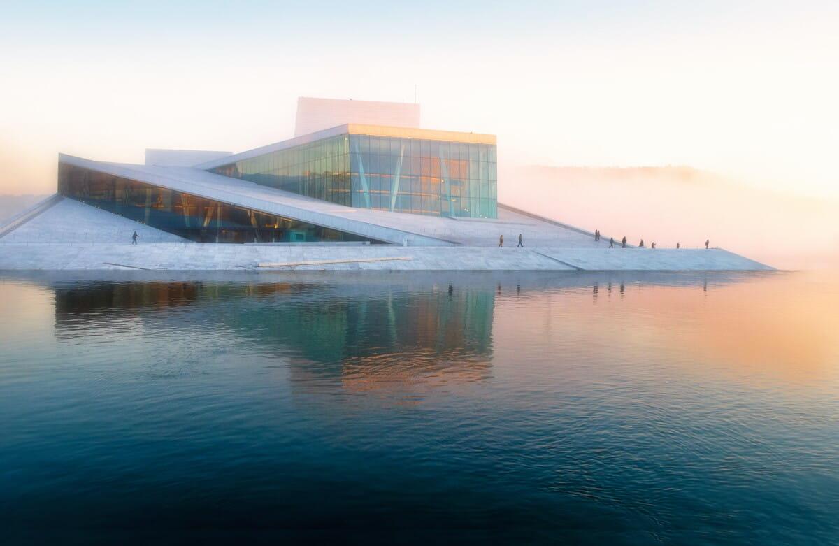gray building near body of water under white sky.jpg