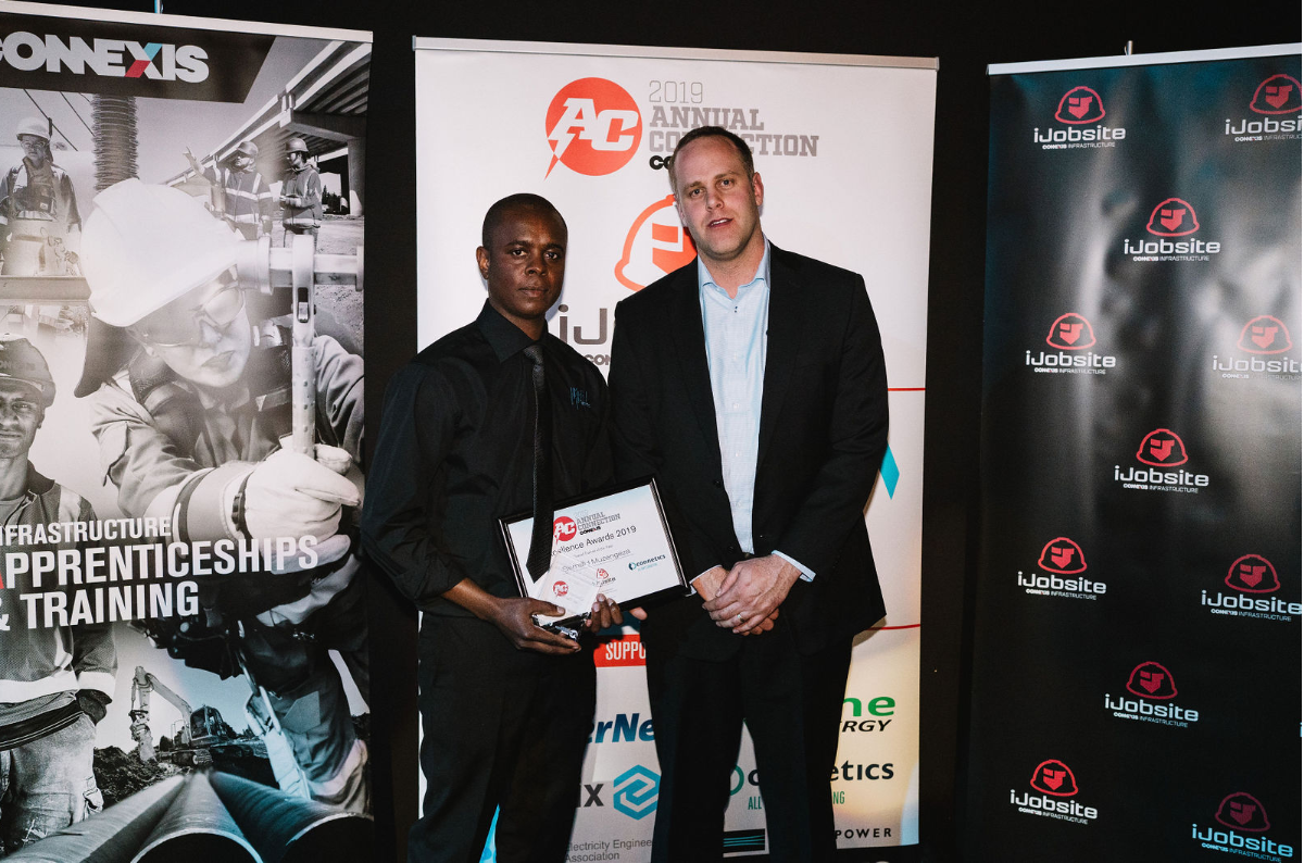 Overall Trainee of the Year Bernard Muzengeza Wel Networks Waikato with Daniel Woollaston Connetics Wellington Manager.PNG