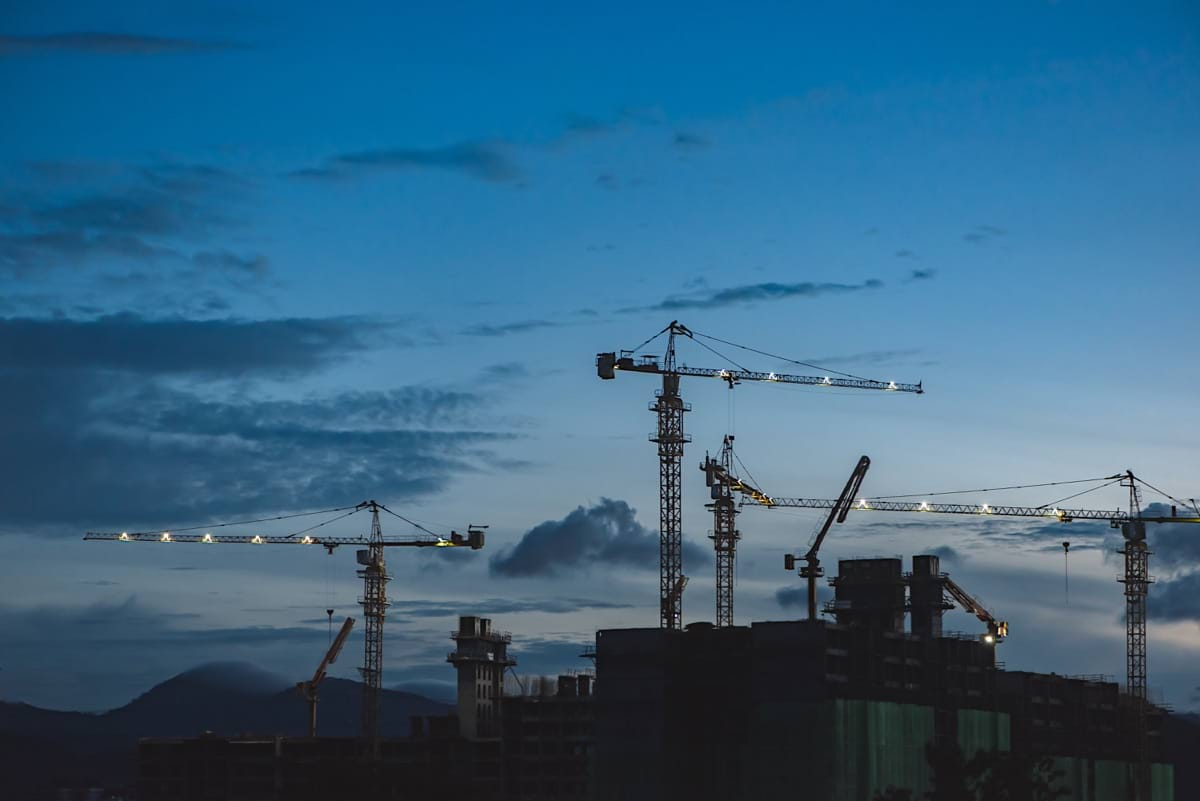 several cranes above the buildings.jpg
