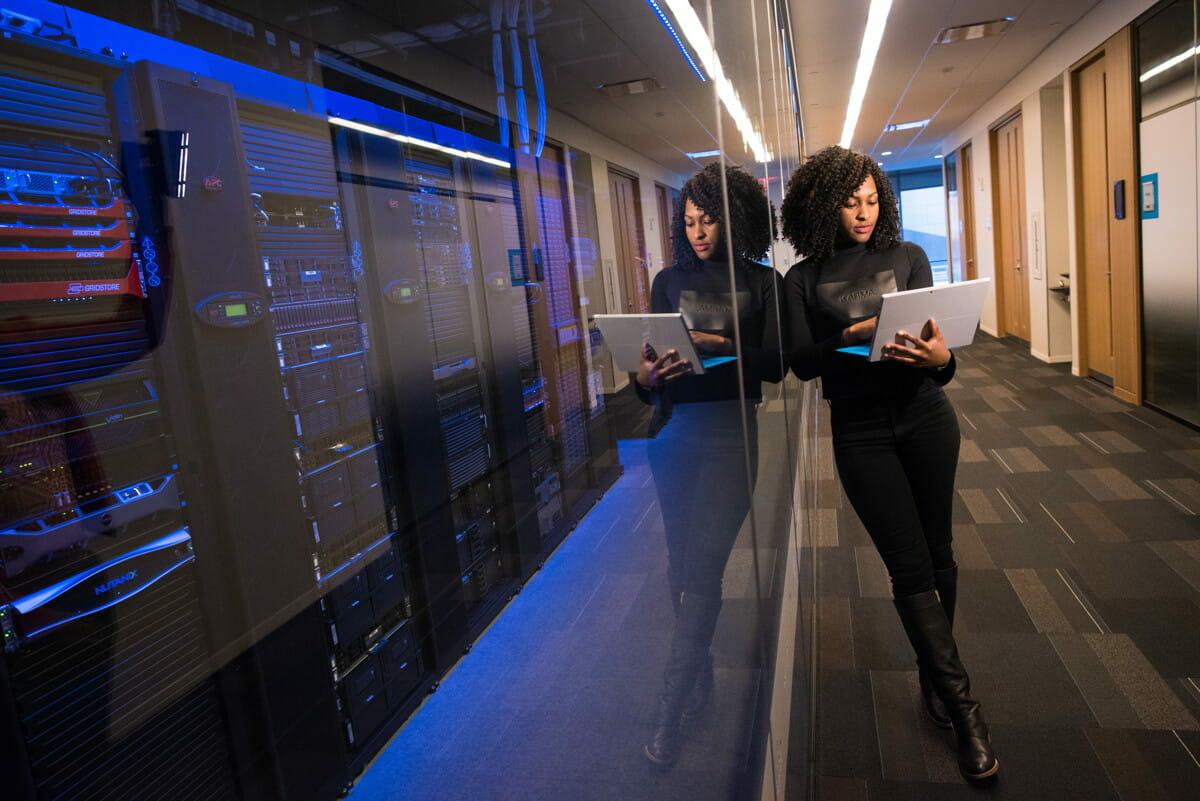 woman in black top using MacBook.jpg