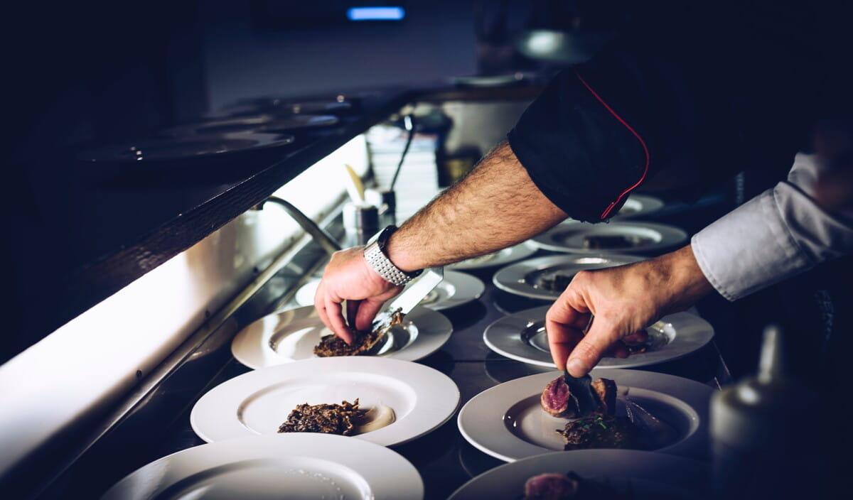 person preparing cooked dish.jpg
