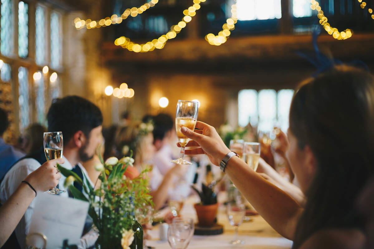 people raising wine glass in selective focus photography.jpg